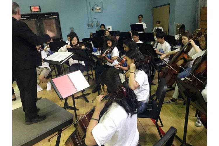 Seoul American students perform the U.S. and Korean national anthems during a closing ceremony for the school complex on Yongsan Garrison, South Korea, Monday, June 3, 2019. (DAVE ORNAUER/STARS AND STRIPES)