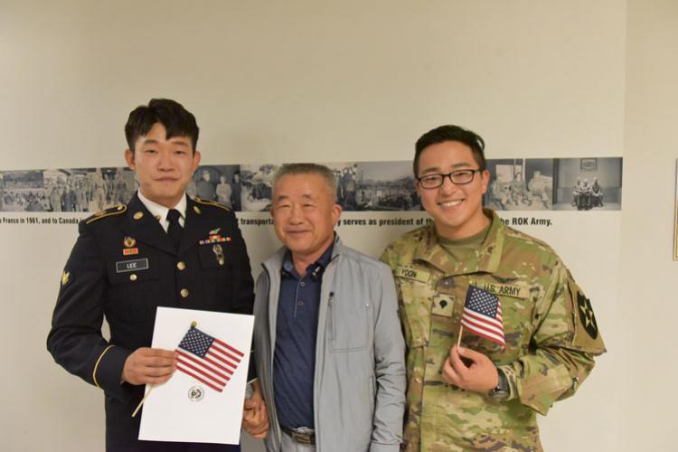 (Left) Pfc. Namhum Lee, his father Lee Jong Ok, and Pfc. Seaokwon Yoon, poise after a naturalization ceremony at Camp Humphreys, May 22. Pfc. Lee received his U.S. citizenship certificate. (Photo Credit: U.S. Army Photo by Kim Won Hyeong)