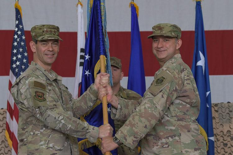 U.S. Air Force Lt. Gen. Kenneth Wilsbach (left), Seventh Air Force commander, presents the guidon to the 51st Fighter Wing's newest commander, Col. John Gonzales (right), during a change of command ceremony, June 18, 2019, at Osan Air Base, Republic of Korea. (U.S. Air Force photo by Staff Sgt. Greg Nash)