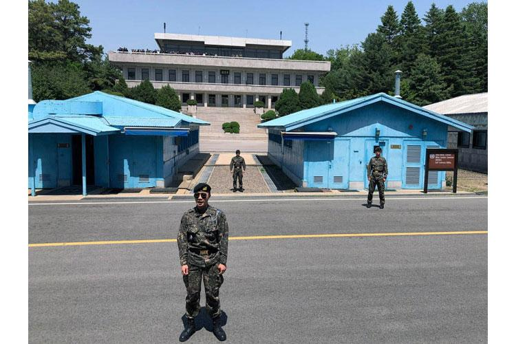 Waiting North Korean visitors are visible atop the building at upper left as South Korean guards take positions during a Joint Security Area tour on Wednesday, May 29, 2019. (JOSEPH DITZLER/STARS AND STRIPES)