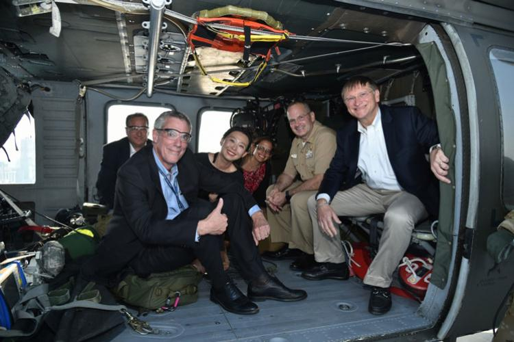 Dr. Robert P. Kadlec (far right) sits aboard an air ambulance from the 377th Medical Company based at Camp Humphreys, South Korea, June 25. Kadlec is the assistant secretary for the Department of Health and Human Services Preparedness and Response and was accompanied by officials from the HHS. Kadlec's visit was to learn about command capabilities pertaining to emergency response within the Korean Theater of Operation. (Courtesy photo by Jong Chan Kim)