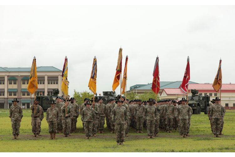Soldiers of the 3rd Armored Brigade Combat Team, 1st Cavalry Division, stand in formation following the uncasing of their colors during a Transfer of Authority ceremony on Camp Humphreys, Republic of Korea June 11. The Greywolf Brigade assumed the nine month rotational unit mission from 3rd Armored Brigade, 1st Armor Division. (Photo Credit: Capt. Scott Kuhn)