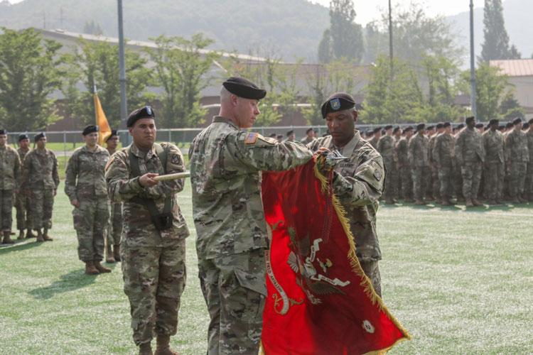 Lieutenant Col. James Raines (left), commander, 2nd Battalion, 18th Field Artillery Regiment (Rotational), 210th Field Artillery Brigade and Cartersville, Georgia native, and Command Sgt. Maj. James Platt Jr., 2-18 FAR command sergeant major and Tulsa, Oklahoma native, , unfurl the battalion colors during a transfer of authority ceremony, July 19, at Camp Casey, Republic of Korea. (U.S. Army photo by Sgt. Osvaldo Martinez)
