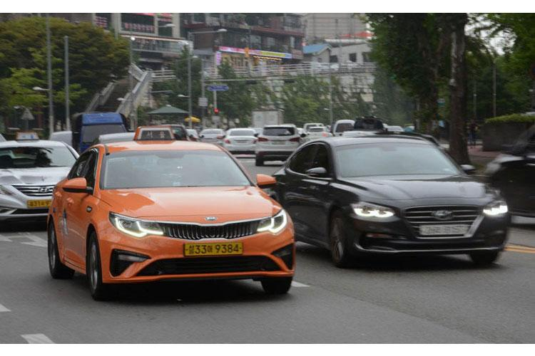 A taxi makes its way along the streets near Itaewon, in Seoul, South Korea, on Thursday, July 25, 2019. (KIM GAMEL/STARS AND STRIPES)