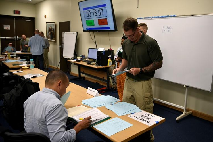 Airmen from the 8th Fighter Wing participate in a role-playing exercise mimicking a clinic customer service process during a Continuous Process Improvement class at Kunsan Air Base, Republic of Korea, July 11, 2019. The participants dealt with redundant processes, before learning to write a problem statement and find innovative solutions. (U.S. Air Force photo by Technical Sgt. Joshua P. Arends)