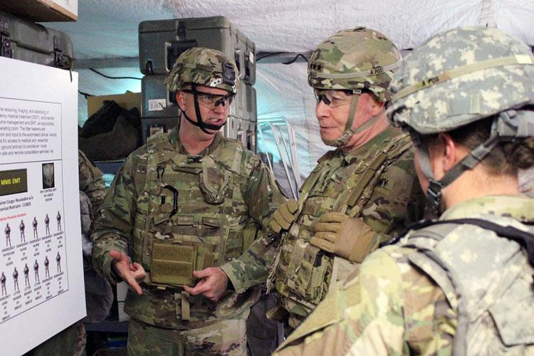 Col. Andrew Landers, M.D., left, briefs Lt. Gen. Michael Bills, Eighth Army commander, on the field hospital conversion concept at Rodriquez Range, South Korea, in March 2019. (U.S. ARMY)