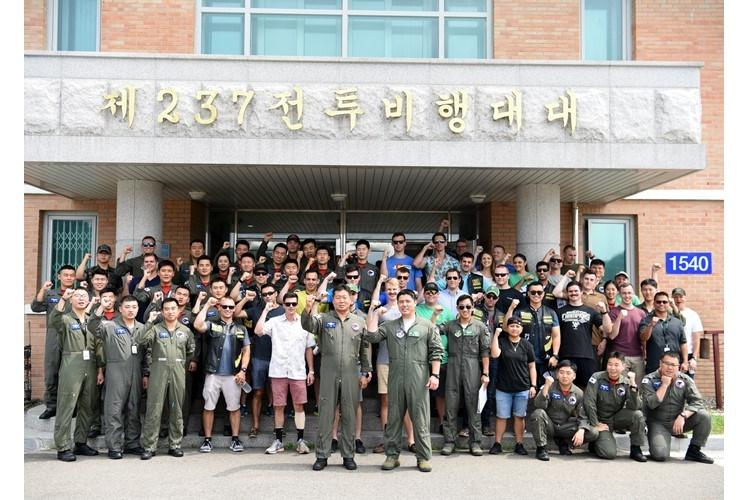 "Members of the 25th Fighter Squadron at Osan Air Base, Republic of Korea, and the 237th and 103rd FS's at Wonju AB, ROK pose for a group photo during a during a ""friendship day"" visit August 21, 2019. This ""friendship day"" allowed the U.S. and ROKAF military members the opportunity to integrate and strengthen their relationships. (U.S. Air Force photo by Staff Sgt. James L. Miller)"