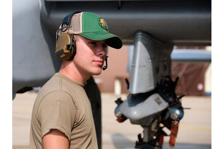 Airman 1st Class Chrisdien Scarlett, an A-10 Thunderbolt II crew chief with the 25th Aircraft Maintenance Unit, wears his bump cap at Osan Air Base, South Korea, Wednesday, Aug. 28, 2019. (MATTHEW KEELER/STARS AND STRIPES)