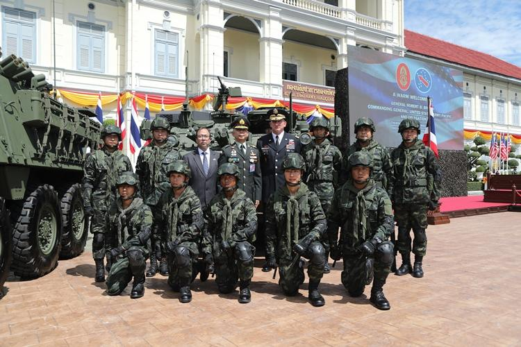 Gen. Robert B. Brown (right rear), U.S. Army Pacific commanding general, and Gen. Apirat Kongsompong (left rear), Royal Thai Army commander-in-chief stand in front of Royal Thai Army Strykers, during a Stryker handover ceremony Sept. 12, 2019 in Bangkok, Thailand. (Photo Credit: Staff Sgt. Kevin Martin)