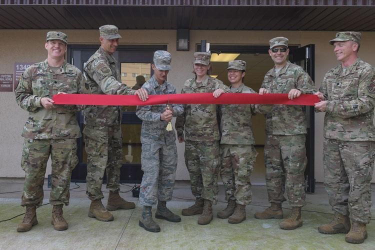 Team Osan's 51st Mission Support Group and 51st Maintenance Group held a ribbon cutting ceremony to celebrate a dormitory renovation project, Sept. 26, 2019, at Osan Air Base, Republic of Korea. The $4.6 million renovated dorm building 1349 will soon house over 100 A-10C Thunderbolt and F-16 Fighting Falcon maintainers, who will experience an enhanced quality of life. (U.S. Air Force photo by Staff Sgt. Greg Nash)