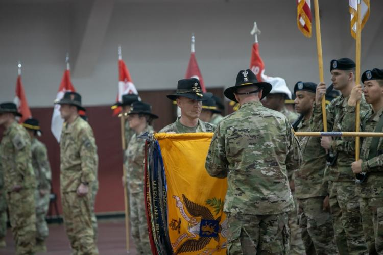 Lt. Col. Derrick Smith, commander, 4-6th Heavy Attack Reconnaissance Squadron and Enterprise, Alabama native, and Command Sgt. Maj. Steven Hartman, 4-6th HARS command sergeant major and Medford, New Jersey native, uncase the battalion colors during a Transfer of Authority ceremony at Camp Humphreys, March 1. (U.S. Army Sgt. Courtney Davis, 2CAB Public Affairs)