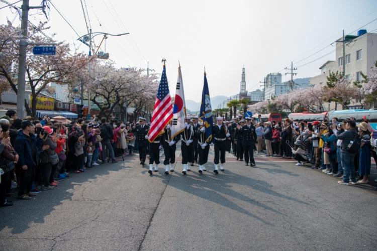 CHINHAE, Republic of Korea (April 05, 2019) Sailors assigned to Commander, Fleet Activities Chinhae (CFAC) march in the 57th annual Jinhae Gunhangje military port festival parade. The festival honors Admiral Yi Sun-sin, a great naval hero of Korea, whose victories still inform the fighting spirit of the ROK Navy. (U.S. Navy photo by Mass Communication Specialist 3rd Class William Carlisle)