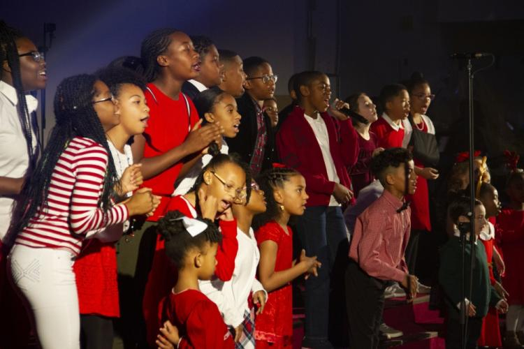 The Children's Choir performed as part of Camp Walker's Christmas Cantata at the Camp Walker Chapel Dec 14. The Area IV Christmas Cantata was held to help give those stationed in Korea of taste of home during the holiday season. (U.S. Army photo by Pfc. Jacob Ward)