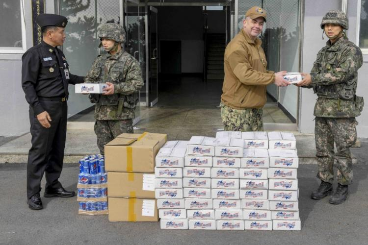 PYEONGTAEK, Republic of Korea (Jan. 29, 2020) Command Master Chief Chris Detje and Republic of Korea Master Chief Petty Officer of the Navy Jeong Do-Il hand care packages to ROK Navy sailors. Sailors assigned to Commander, Naval Forces Korea and the ROK MCPON delivered these packages from Operation Gratitude to ROK Sailors stationed in the vicinity of YeonPyeong Island to strengthen ties between the two allied nations. (U.S. Navy Photo by Mass Communication Specialist 2nd Class Michael Chen/Released)