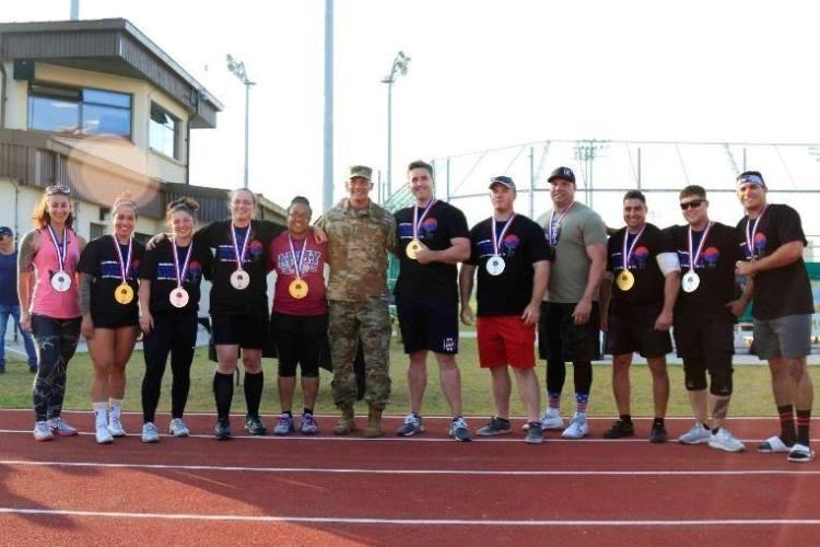 Gina Petrino (far left), a U.S. Army Corps of Engineers, Far East District contract specialist, after she won 2nd place for her weight class at the 2019 U.S. Army Garrison Humphreys Strongest Warrior competition, at Balboni Field, Camp Humphreys, South Korea, Oct. 19.