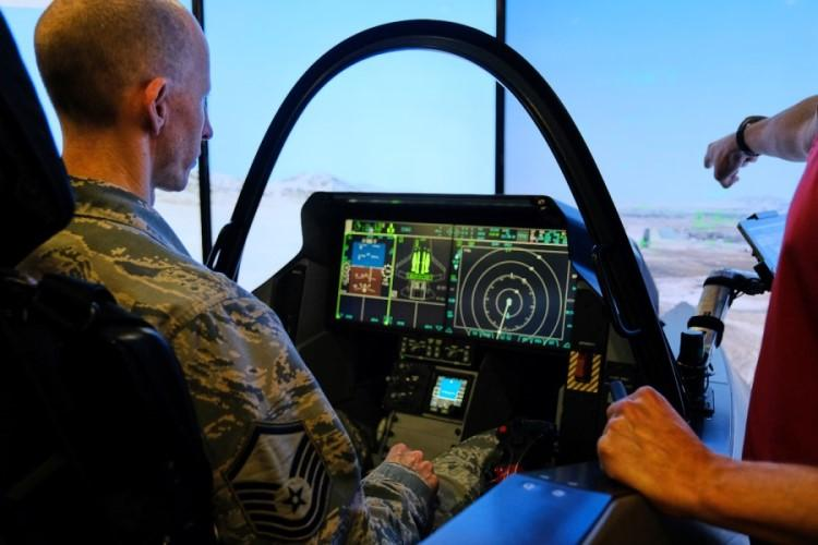 Master Sgt. David Snowman of the 51st Fighter Wing tries out an F-35 Lightning II simulator at Osan Air Base, South Korea, Thursday, Oct. 24, 2019. (MATTHEW KEELER/STARS AND STRIPES)