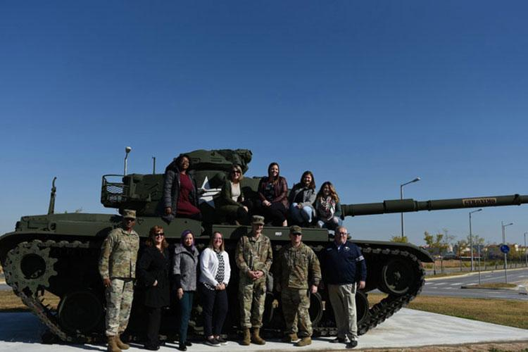 "Members of various local social media groups and garrison leadership team, poise for a group photo during the first ""Straight Talk with the Commander,"" Nov. 14.  (Photo Credit: Jamie Han, USAG Humphreys Public Affairs intern)"