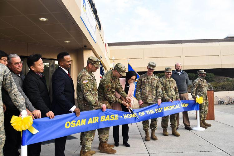 Col. Christopher Crary, U.S. Army Corps of Engineers (USACE), Far East District (FED) commander, along with other distinguished guests, participate in the 51st Medical Group Hospital expansion and renovation ribbon cutting ceremony, Osan Air Base, South Korea, Nov. 26.