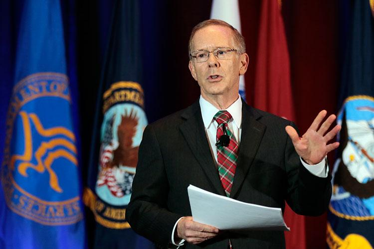 Barclay Butler, Ph.D., MBA, assistant director of management at DHA, explains the market concept to an audience of active-duty and civilian conference attendees at the 2019 AMSUS Annual Meeting in National Harbor, Maryland, Dec. 4. (Photo by MHS Communications)
