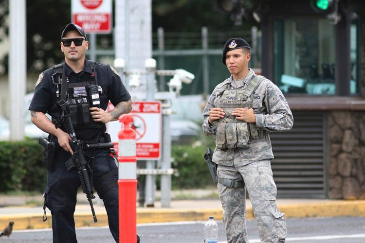 Security stands guard outside the main gate at Joint Base Pearl Harbor-Hickam, in Hawaii, Wednesday, Dec. 4, 2019. (AP)