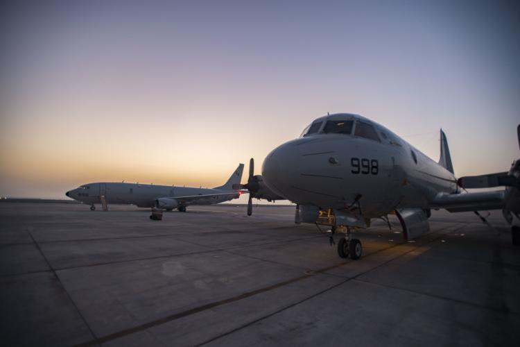 "U.S. Navy file photo of a P-3 Orion, left, assigned to Patrol Squadron (VP) 40, and a P-8A Poseidon from the ""Mad Foxes"" of Patrol Squadron (VP) 5. VP-5. (Photo by Mass Communication Specialist 2nd Class Jakoeb Vandahlen)"