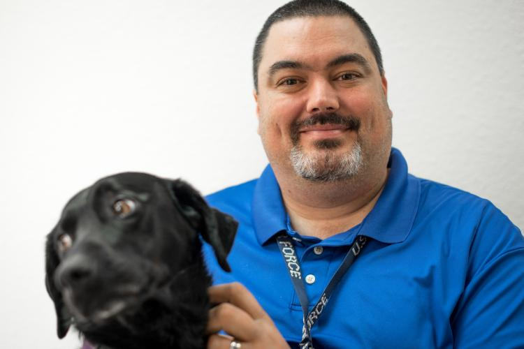 Kevin Waterhouse, along with his service dog Jade, serves as the wing commander's secretary for the 403rd Wing at Keesler Air Force Base, Miss. He was in an accident at age 17 that left him paralyzed from the chest down. (U.S. Air Force photo by Staff Sgt. Shelton Sherrill)