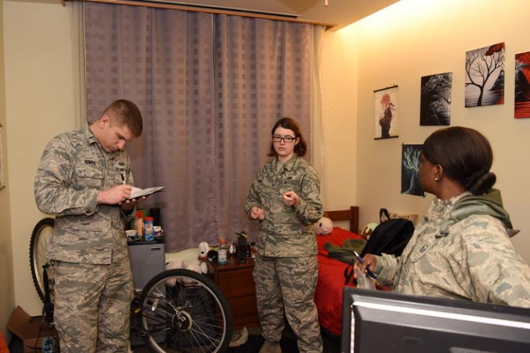 U.S. Air Force 1st Lt. Ryan Neimes, 8th Comptroller Squadron financial operations flight commander, takes notes while Senior Airman Allisha Quinn, 8th CPTS permanent change of station section specialist, talks about her dorm at Kunsan Air Base, Republic of Korea, Feb. 26, 2019. Neimes visited with all CPTS non-commissioned officers and junior airmen to check the quality of the rooms and to see if his personnel had any issues. (U.S. Air Force photo by Staff Sgt. Joshua Edwards)