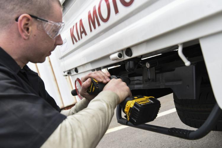 U.S. Air Force Staff Sgt. Joey Hines, 8th Logistics Readiness Squadron vehicle management supervisor, installs license plates on brand new vehicles at Kunsan Air Base, Republic of Korea, April 9, 2019. Eight units at Kunsan are receiving the vehicles, guaranteeing pivotal increased mission capability. (U.S. Air Force photo by Senior Airman Savannah L. Waters)