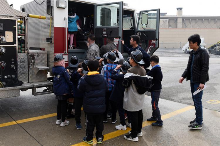 Students from Songshin Elementary School walk through a 51st Civil Engineer Squadron fire engine during a visit to Osan Air Base, Republic of Korea, April 11, 2019. The visit was part of the Songshin Little Explorers Program that gives students the opportunity to visit different Osan squadrons and learn about their mission. (U.S. Air Force photo by Staff Sgt. Sergio A. Gamboa)