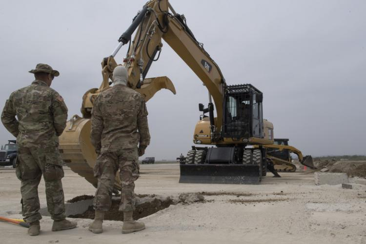 U.S. Airmen and Soldiers excavate a repair site during rapid airfield damage repair (RADR) training at Osan Air Base, Republic of Korea, April 19, 2019. RADR is a quick process used to repair structural damages on an airfield where civil engineers evaluate damages, prepare areas for repair and pour concrete to get the airfield back to mission ready. (U.S. Air Force photo by Staff Sgt. Ramon A. Adelan)