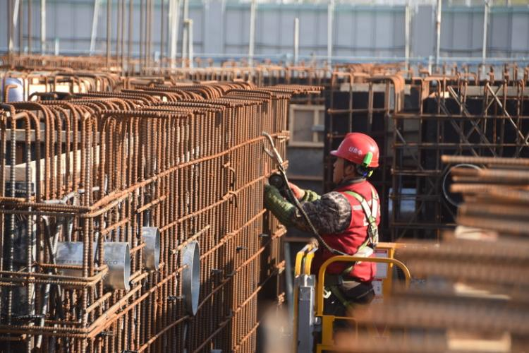 A construction worker from a Korean contracting firm performs work at one of the many construction projects overseen by the far East District.