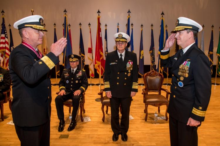 BUSAN, Republic of Korea (April 25, 2019) Rear Adm. Michael P. Donnelly renders a salute to Vice Adm. Phil J. Sawyer, commander, U.S. 7th Fleet, during a change of command ceremony aboard the Republic of Korea (ROK) Fleet base in Busan. Donnelly relieved Rear Adm. Michael E. Boyle to become the 37th commander of U.S. Naval Forces Korea. (Photo by Mass Communication Specialist 3rd Class William Carlisle)