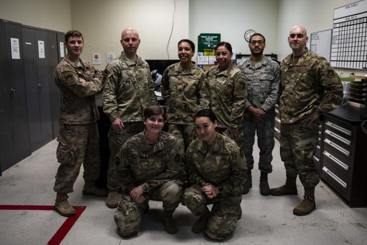 Members of the 8th Operations Support Squadron aircrew flight equipment flight from the 35th and 80th Fighter Squadrons pose for a photo at Kunsan Air Base, Republic of Korea, April 29, 2019. The 8th OSS AFE flight is split up in two different fighter squadrons, but will work together when manning is low due to TDYs or deployments to keep the mission going. (U.S. Air Force photo by Senior Airman Stefan Alvarez)