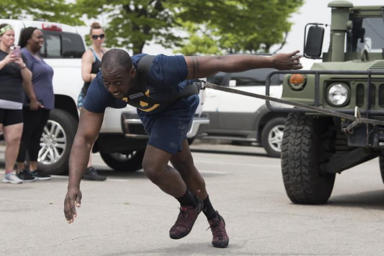 U.S. Air Force Staff Sgt. Jaye Moye pulls a HMMWV during Osan's Strongest Warrior Competition at Osan Air Base, Republic of Korea, May 4, 2019. The competition involved five events to include the atlas stone lift, farmer's walk, axel deadlift, press medley and HMMWV pull. Moye, a native of Eastman, Georgia, is a weapons load crew team chief with the 51st Aircraft Maintenance Squadron.