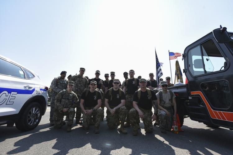 Members from the 8th Security Forces Squadron pose for a photo before a National Police Week memorial ruck at Kunsan Air Base, Republic of Korea, May 13, 2019. National Police Week honors those who serve and have served in law enforcement, as well as memorializes those who've made the ultimate sacrifice. (U.S. Air Force photo by Senior Airman Savannah L. Waters)