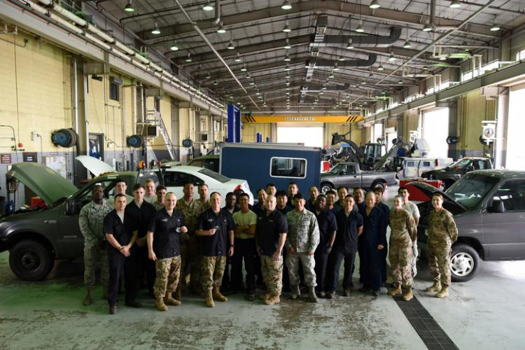 U.S. Air Force Col. Tad Clark, 8th Fighter Wing commander, Col. Lawrence Sullivan, 8th FW vice commander, and Chief Master Sgt. Steve Cenov, 8th FW command chief, visit with the 8th Logistics Readiness Squadron at Kunsan Air Base, Republic of Korea, July 11, 2019. The 8th FW top leadership regularly familiarizes themselves with individual squadrons. (U.S. Air Force photo by Staff Sgt. Joshua Edwards)