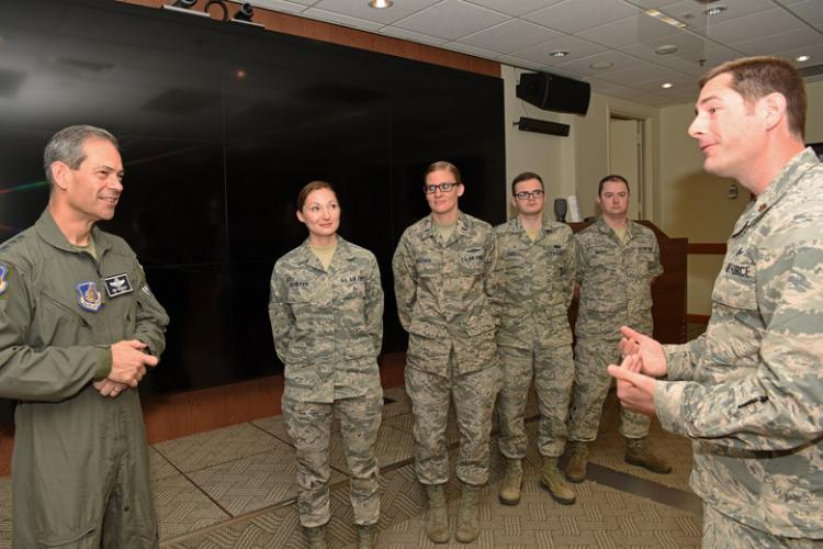 U.S. Air Force Lt. Gen. Kenneth S. Wilsbach, 7th Air Force commander, speaks with Maj. Dustin Burleson, 8th Communications Squadron commander, about the communication security team at Kunsan Air Base, Republic of Korea, July 19, 2019. Wilsbach visited Kunsan to recognize several Airman and hold a town hall meeting for officers. (U.S. Air Force photo by Staff Sgt. Joshua Edwards)