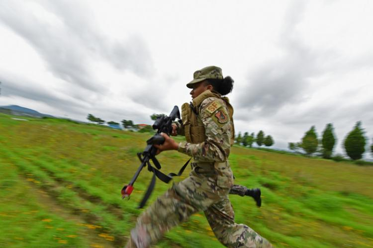 Senior Airman Tequera Anderson, 736th Security Forces Squadron fire team member, runs for cover during shoot, move, communicate training July 24, 2019, at Gwangju Air Base, Republic of Korea. Shoot, move, communicate is a fundamental drill for U.S. Air Force Security Forces to develop tactile moving habits when under fire. (U.S. Air Force photo by Staff Sgt. James L. Miller)