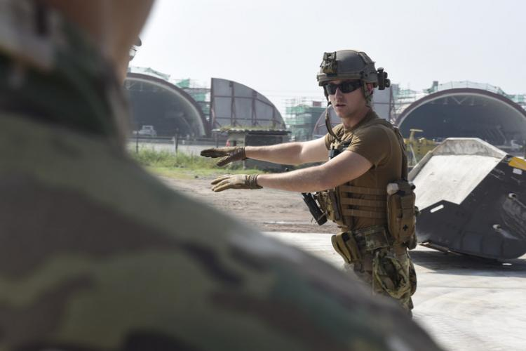 Staff Sgt. Zachary McCarthy, 8th Civil Engineer Squadron Explosive Ordnance Disposal technician, teaches how to properly clear unexploded ordnance during a joint training with the 38th Fighter Group EOD unit at Kunsan Air Base, Republic of Korea, Aug. 22, 2019. The training gave both the 8th CES and 38th FG EOD units the opportunity to share techniques and practice disposing of ordnance. (U.S. Air Force photo by Staff Sgt. Mackenzie Mendez)