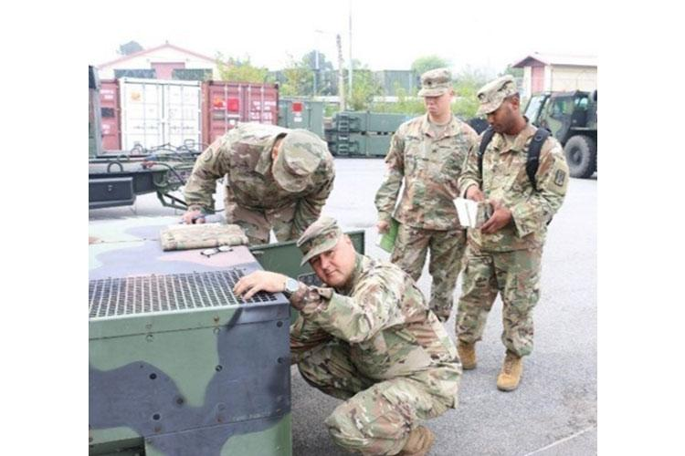 Chief Warrant Officer 4 Arroyo, Chief Warrant Officer 3 Hayes, Chief Warrant Officer 2 Castro and Staff Sgt. Galindo inspect an E Company generator as part of the Army Award for Maintenance Excellence.