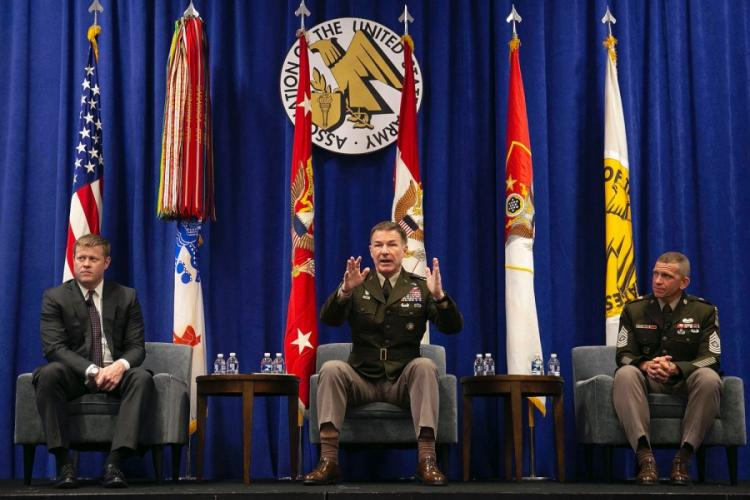 Army Chief of Staff Gen. James McConville, center, speaks at the 2019 AUSA Annual Meeting and Exposition in Washington, D.C., Oct. 15, 2019. Sitting with McConville is Secretary of the Army Ryan McCarthy, left, and Sgt. Maj. Michael Grinston. JENNIFER MILBRETT FOR AUSA