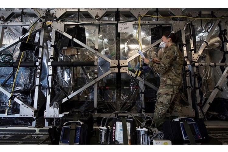 U.S Air Force Capt. Naomi King, 628th Operational Medical Readiness Squadron infectious disease team lead, reviews COVID-19 cleaning procedures with Airmen in the Transport Isolation System at Joint Base Charleston, South Carolina, April 5, 2020. The TIS is an infectious disease containment unit designed to minimize risk to aircrew and medical attendants, while allowing in-flight medical care for patients affected by contagions like COVID-19. (U.S. Air Force photo by Senior Airman Allison Payne)