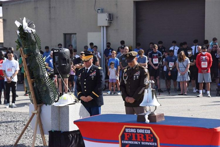 USAG Daegu Commander Col. Brian P. Schoellhorn and Command Sgt. Maj. Jonathon J. Blue led a wreath-laying ceremony and saluted in front of a makeshift 9/11 memorial—on the 20th anniversary of 9/11—to honor and remember the memories of those lost on 9/11 and all the patriots and their families who have sacrificed in defense of freedom. (U.S. Army)