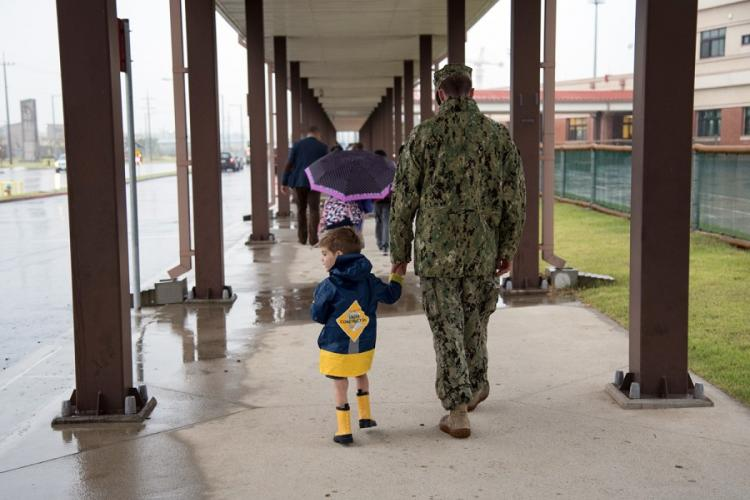 A father and son walk hand-in-hand on the first day of school at Humphreys Central Elementary School in South Korea, Aug. 27. 2018. MARYAM TREECE/U.S. ARMY