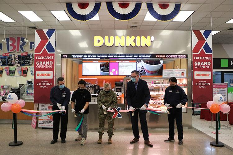 (From) Exchange General Manager Boris Nasci; Yang, Kyong-sok, Dunkin' store owner; Col. Jonelle Eychner, 51st Mission Support Group commander; Scott Bonner, Exchange regional vice president; and Pak, Kye-hwan cut the ribbon on the new Dunkin' Donuts at the Osan Air Base Exchange. (AAFES Photo by Kim, Ung-chol)
