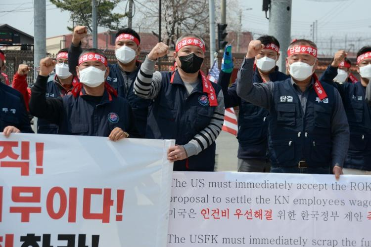 Members of the South Korean employees' union protest the U.S. Forces Korea furlough outside the main gate at Camp Humphreys, South Korea, Wednesday, April 1, 2020. KIM GAMEL/STARS AND STRIPES