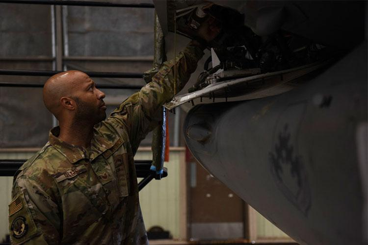U.S Air Force Tech. Sgt. Pierce Gillis, 8th Maintenance Group quality inspector, ensures an environmental control system duct cap is securely tightened at Kunsan Air Base, Republic of Korea, May 18, 2020. QA's primary mission is to inspect and ensure maintenance processes are being completed in accordance with Air Force Instructions to ensure the safety of all personnel. (U.S. Air Force photo by Senior Airman Jessica Blair)