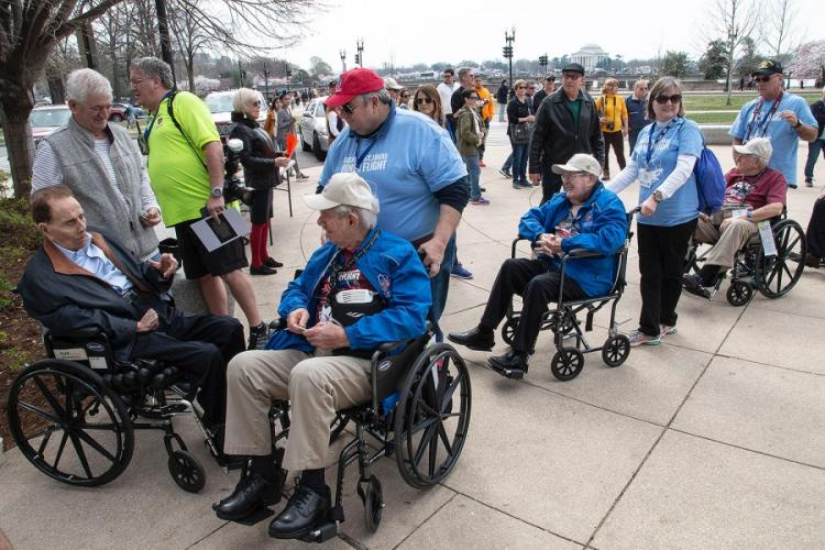 Former Sen. Bob Dole greets fellow veterans who were visiting the National World War II Memorial in Washington, D.C. on an Honor Flight in March 2019. STARS AND STRIPES