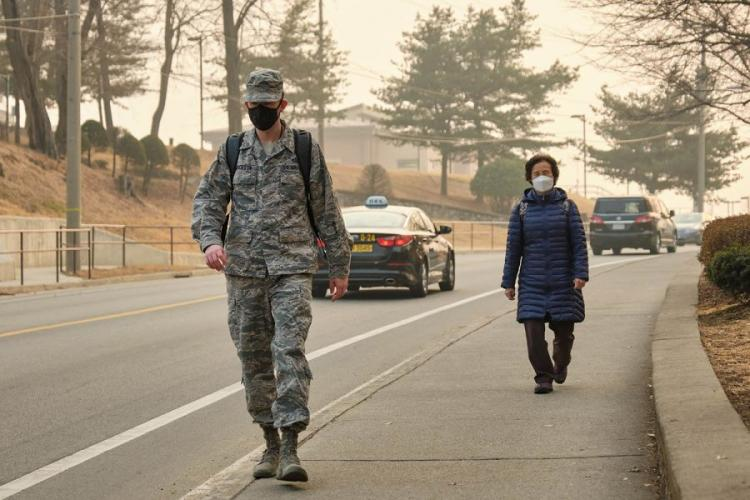 Pedestrians wear air-filtering masks at Osan Air Base, South Korea, March 6, 2019. Since 2017, the Air Force has permitted masks when pollution hit a certain level. But before a recent change, Army regulations had barred most soldiers from wearing filtering masks in uniform.  MATT KEELER/STARS AND STRIPES