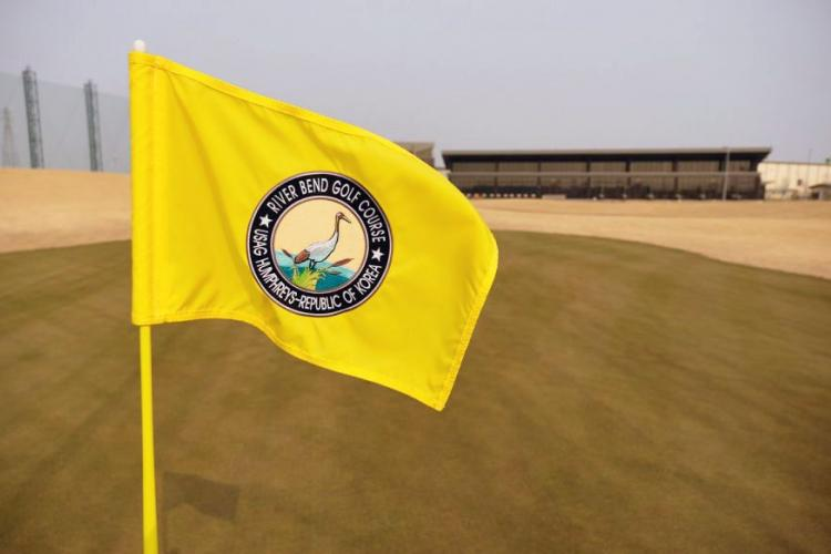 The pin flag at the 18th hole of the new River Bend Golf Course waves at Camp Humphreys, South Korea, March 27, 2019. MATT KEELER/STARS AND STRIPES